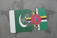 Puzzle with the national flag of pakistan and dominica on a world map background. 3D illustration stock photos