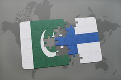 Puzzle with the national flag of pakistan and finland on a world map background. 3D illustration Royalty Free Stock Images