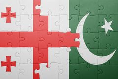 Puzzle with the national flag of pakistan and georgia. Concept Royalty Free Stock Photos