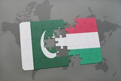 Puzzle with the national flag of pakistan and hungary on a world map background. Stock Images