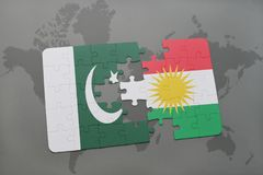 Puzzle with the national flag of pakistan and kurdistan on a world map background. 3D illustration Stock Photography