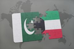 Puzzle with the national flag of pakistan and kuwait on a world map background. 3D illustration Stock Photo
