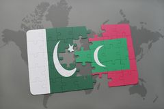 Puzzle with the national flag of pakistan and maldives on a world map background. Royalty Free Stock Photo
