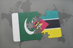 Puzzle with the national flag of pakistan and mozambique on a world map background. 3D illustration Royalty Free Stock Images