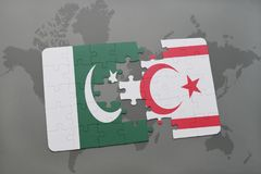 Puzzle with the national flag of pakistan and northern cyprus on a world map background. Royalty Free Stock Photo