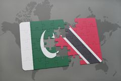 Puzzle with the national flag of pakistan and trinidad and tobago on a world map background. 3D illustration Royalty Free Stock Images