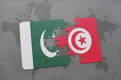 Puzzle with the national flag of pakistan and tunisia on a world map background. 3D illustration Stock Image