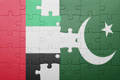 Puzzle with the national flag of pakistan and united arab emirates. Concept Royalty Free Stock Photos