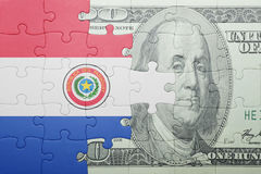 Puzzle with the national flag of paraguay and dollar banknote Stock Photos