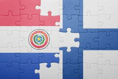 Puzzle with the national flag of paraguay and finland Stock Image