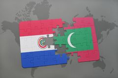 Puzzle with the national flag of paraguay and maldives on a world map. Background. 3D illustration Royalty Free Stock Image