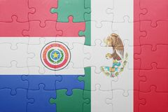 Puzzle with the national flag of paraguay and mexico. Concept stock photography