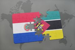 Puzzle with the national flag of paraguay and mozambique on a world map. Background. 3D illustration Royalty Free Stock Photos