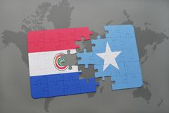 Puzzle with the national flag of paraguay and somalia on a world map. Background. 3D illustration stock photos
