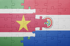 Puzzle with the national flag of paraguay and suriname Stock Photography