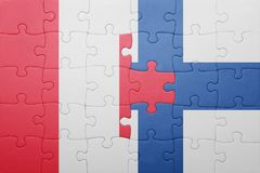Puzzle with the national flag of peru and finland Stock Photo