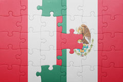 Puzzle with the national flag of peru and mexico. Concept royalty free stock image