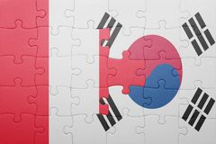 Puzzle with the national flag of peru and south korea. Concept royalty free stock photo