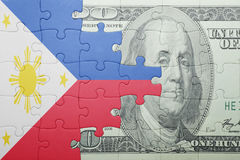 Puzzle with the national flag of philippines and dollar banknote Royalty Free Stock Images