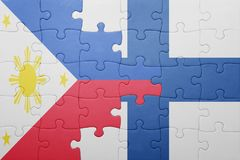 Puzzle with the national flag of philippines and finland. Concept Stock Images