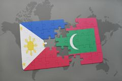 Puzzle with the national flag of philippines and maldives on a world map background. Royalty Free Stock Photos