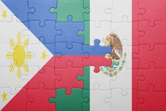 Puzzle with the national flag of philippines and mexico. Concept royalty free stock photos