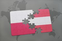 Puzzle with the national flag of poland and austria on a world map background. 3D illustration Stock Photo
