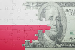 Puzzle with the national flag of poland and dollar banknote. Concept Stock Images