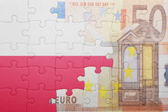 Puzzle with the national flag of poland and euro banknote Royalty Free Stock Photo