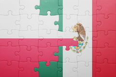 Puzzle with the national flag of poland and mexico. Concept stock photo