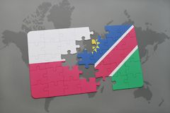 Puzzle with the national flag of poland and namibia on a world map background. 3D illustration stock photography