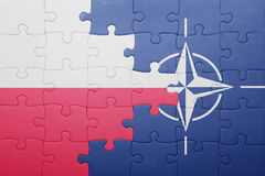 Puzzle with the national flag of poland and nato. Concept stock image