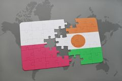 Puzzle with the national flag of poland and niger on a world map background. 3D illustration stock photos