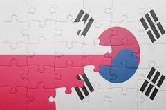 Puzzle with the national flag of poland and south korea. Concept royalty free stock images