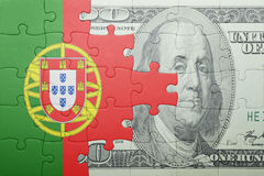 Puzzle with the national flag of portugal and dollar banknote. Concept stock illustration