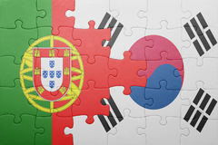 Puzzle with the national flag of portugal and south korea. Concept royalty free stock image
