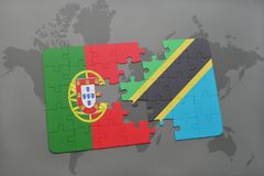 puzzle with the national flag of portugal and tanzania on a world map background. Stock Photo