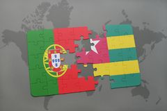 puzzle with the national flag of portugal and togo on a world map background. Stock Images