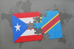 Puzzle with the national flag of puerto rico and democratic republic of the congo on a world map Stock Photo