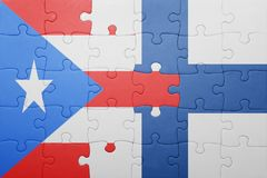 Puzzle with the national flag of puerto rico and finland Stock Photo