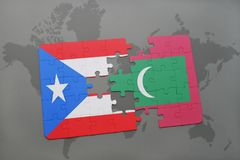 Puzzle with the national flag of puerto rico and maldives on a world map. Background. 3D illustration Royalty Free Stock Photography