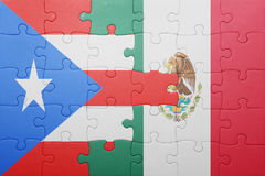 Puzzle with the national flag of puerto rico and mexico. Concept royalty free stock image