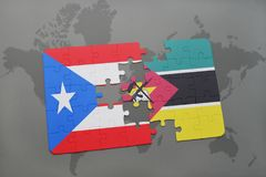 Puzzle with the national flag of puerto rico and mozambique on a world map. Background. 3D illustration Royalty Free Stock Photography