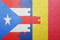Puzzle with the national flag of puerto rico and romania Stock Photos