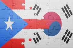 Puzzle with the national flag of puerto rico and south korea. Concept royalty free stock images