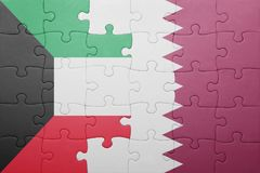 Puzzle with the national flag of qatar and kuwait. Concept Royalty Free Stock Photo
