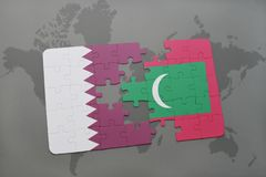 Puzzle with the national flag of qatar and maldives on a world map background. Royalty Free Stock Photo