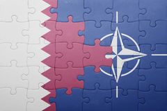 Puzzle with the national flag of qatar and nato Royalty Free Stock Image