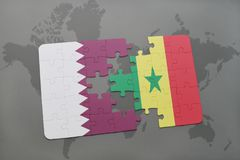 puzzle with the national flag of qatar and senegal on a world map background. Stock Photography