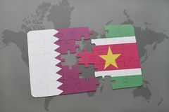 Puzzle with the national flag of qatar and suriname on a world map background. 3D illustration Stock Image